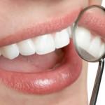 White teeth and dental mirror